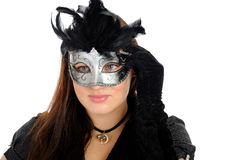 Beautiful brunette woman in party carnival mask . Beautiful brunette woman in black dress in party carnival mask . isolated on white background Stock Images