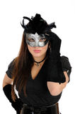 Beautiful brunette woman in party carnival mask . Beautiful brunette woman in black dress in party carnival mask . isolated on white background Royalty Free Stock Images