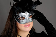 Beautiful brunette woman in party carnival mask . Beautiful sexy woman in black dress in party carnival mask . isolated on white background Royalty Free Stock Photos
