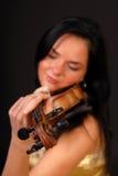 Beautiful brunette woman paying violin Royalty Free Stock Image