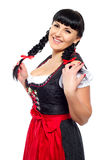 Beautiful brunette woman with pigtails in the Bavarian dressed smiling Stock Photo