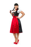 Beautiful brunette woman with pigtails in the Bavarian dressed smiling Royalty Free Stock Photos
