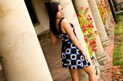 Beautiful brunette woman and pillars Stock Photo
