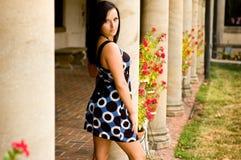 Beautiful brunette woman and pillars Stock Photos