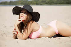 Beautiful brunette woman in pink bikini Royalty Free Stock Photo