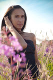 Beautiful brunette woman in pink flowers Royalty Free Stock Photos