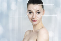 Beautiful brunette woman pointed wrinkles spots. Anti agingtreatment - concept stock photos