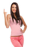 Beautiful brunette woman pointing at copyspace Royalty Free Stock Photography