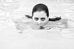 Beautiful brunette woman in pool looking at camer Stock Images