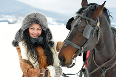 Beautiful brunette woman portrait with horse in winter Royalty Free Stock Photo