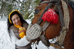 Beautiful brunette woman portrait and horse in winter Stock Photography