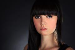 Brunette Woman Portrait over Dark Background Stock Images