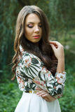 Beautiful brunette woman poses outdoors Royalty Free Stock Image