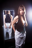 Beautiful brunette woman posing against mirror Royalty Free Stock Photography