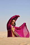 Beautiful brunette woman posing in arabic desert Stock Image