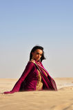 Beautiful brunette woman posing in arabic desert Royalty Free Stock Photos