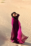 Beautiful brunette woman posing in arabic desert Stock Photography