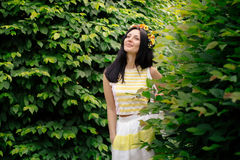 Beautiful brunette woman posing in a garden Stock Photography