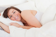 Beautiful brunette woman posing while lying Stock Image