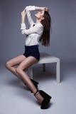 Beautiful brunette woman posing in studio. Fashion shot Royalty Free Stock Image