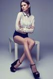 Beautiful brunette woman posing in studio. Fashion shot Stock Photography