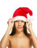 Beautiful brunette woman put on santas hat Royalty Free Stock Photos