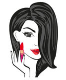 Beautiful brunette woman putting lipstick on Stock Images