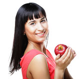 Beautiful brunette woman with red apple in hands Royalty Free Stock Images