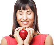 Beautiful brunette woman with red apple in hands Stock Image