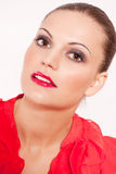 Beautiful brunette woman with red lips and makeup Stock Photo