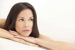 Beautiful Brunette Woman Resting on Her Hands stock photos
