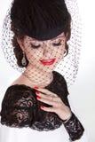 Beautiful Brunette Woman. Retro Fashion portrait in elegant hat Stock Photos