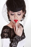Beautiful Brunette Woman. Retro Fashion portrait in elegant hat Royalty Free Stock Image