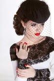Beautiful Brunette Woman. Retro Fashion portrait in elegant hat Stock Photography