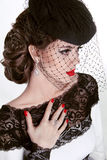Beautiful Brunette Woman. Retro Fashion portrait in elegant hat Royalty Free Stock Photography