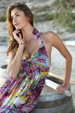 Beautiful brunette woman in romantic summer dress Stock Image