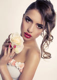 Beautiful brunette woman with roses Stock Photos
