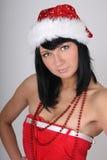Beautiful brunette woman in santa hat Stock Photo