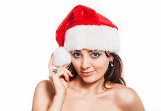 Beautiful brunette woman in Santa hat Royalty Free Stock Photography