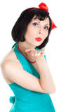 Beautiful brunette woman sending air kiss Stock Images