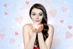 Beautiful brunette woman sending many kisses Stock Images