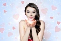 Beautiful brunette woman sending many kisses Stock Images
