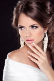 Beautiful Brunette Woman with sexy lips. Hairstyle. Makeup. Mani Royalty Free Stock Photos