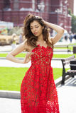 Beautiful brunette woman in red dress Royalty Free Stock Photos
