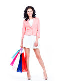 Beautiful brunette woman with shopping bags. Stock Photos