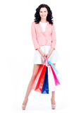 Beautiful brunette woman with shopping bags. Royalty Free Stock Photos