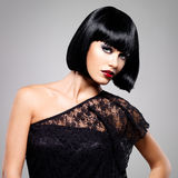 Beautiful brunette woman with shot hairstyle royalty free stock photos