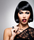 Beautiful brunette woman with shot hairstyle royalty free stock images