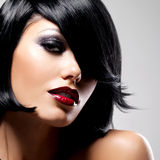 Beautiful brunette woman with shot hairstyle. And sexy red lips. Closeup portrait of a female model with fashion makeup Stock Photos