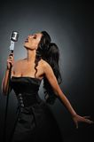Beautiful brunette woman singing. Picture of a Beautiful brunette woman singing royalty free stock image